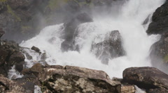 Close up of wild waterfall in the moutains - stock footage