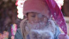 Little Girl, Blows Handful Of Snow At Camera, Her Santa Hat Slides Down, Funny Stock Footage