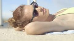 Woman sunbathing on deck Stock Footage