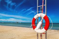 Lifebuoy, Life Preserver on Sandy Beach - stock photo