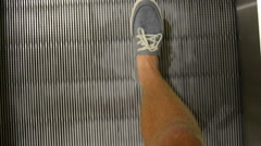 Walking on a moving walkway Stock Footage