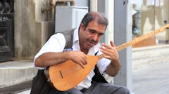 Old man street musician on the istiklal street in Istanbul, Turkey. - stock footage