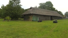 Old barn with thatched roof Stock Footage