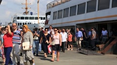 Commuters get off city ferryboat in Eminonu Harbor, Istanbul. Turkey Stock Footage