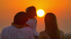 6 in 1 video!  Family (father, mother and daughter) by sunset background Stock Footage