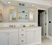 All white luxury master bathroom with vintage theme. - stock photo