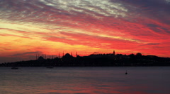Sunset at Istanbul. Setting sun fired up the sky and Bosphorus waters Stock Footage