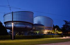 European Court of Human Rights building at dusk Stock Photos