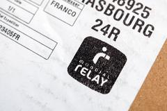 Mondial Relay sticker on cardbox - stock photo