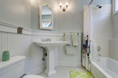Vintage style bathroom with white interior. - stock photo
