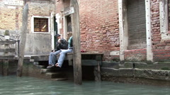 Couple in love sitting on the banks of the canal Stock Footage