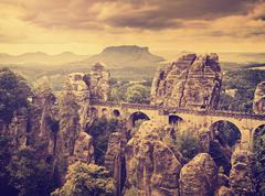 Retro toned Bastei bridge in Saxon Switzerland, Germany. - stock photo