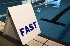 Fast lane sign in swimming pool - stock photo