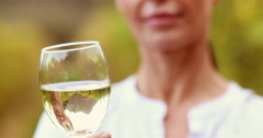Female winegrower swirling a white wine glass Stock Footage