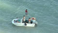 Friends out on the lake for summertime fun - Aerial view Stock Footage