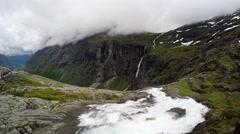 The Trollstigen Road and Stigfossen Waterfall time lapse Stock Footage