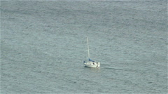 Long shot of a sailboat on the open water - stock footage