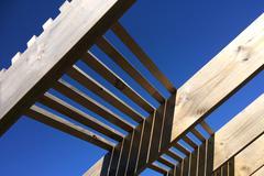 Wooden pergola against blue sky Stock Photos