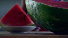 Boy eats watermelon slices red Stock Footage