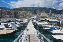 Boats tied in the Monte Carlo harbour, Monaco. Stock Photos