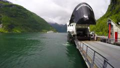Passengers, cars, buses exit the ferry which transports them Stock Footage