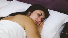 Heartbroken woman in bed thinking about lost love dolly shot Stock Footage