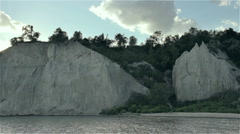 Sunset over bluffs and secluded beach Stock Footage