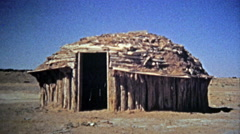 1972: Navajo Native American southwest round housing and people selling jewelry. - stock footage