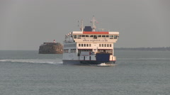Stock Video Footage of Isle of Wight Ferry and Spitbank Fort at Dusk in The Solent Hampshi