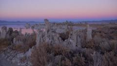 AERIAL: Flying over Mono Lake tufas in colorful sunset - stock footage