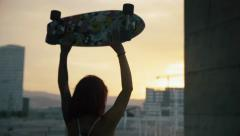 Woman rising his skate board in Barcelona during sunset in slow motion Stock Footage