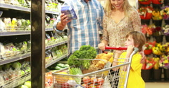 Happy family shopping vegetables Stock Footage
