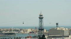 Aerial tramway tower and Port Vell in Barcelona Stock Footage