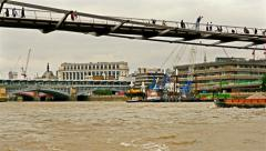 View to London skyline from tour boat passing under Millennium bridge Stock Footage