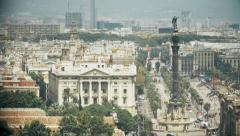 Colon statue and a aerial tramway passing by in Barcelona city Stock Footage