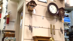 One side of antique wall clocks in a clock store, ticking the time - stock footage