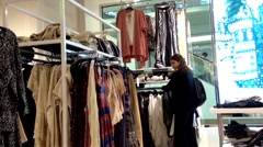 Shopper inside Forever 21 store to buying clothes - stock footage