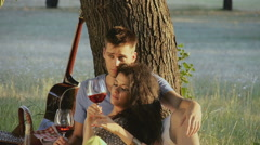 Young couple enjoying love and romance on picnic outdoor Stock Footage
