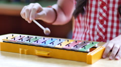 Asian Children playing on colorful xylophone Stock Footage