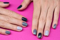 Delicate female hands with a stylish neutral manicure - stock photo