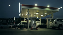 Wide Shot Busy Gas Station at Night Stock Footage