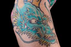Blue Dragon Tattoo on Arm Stock Photos