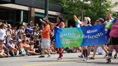 Gay activists walking on gay pride, Burnaby school, Vancouver Stock Footage