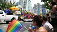 Pride paraders walking, Vancouver, sunny day Stock Footage