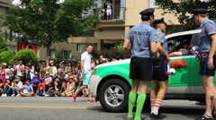 Policemen making fun, gay parade, Vancouver - stock footage