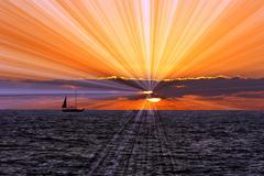Sailboat Sunset Journey - stock photo