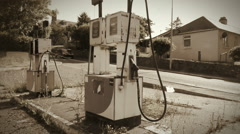 Abandoned Petrol Pumps treated with a Sepia Look Stock Footage