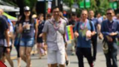 Smiling people walking on pride parade, Vancouver Stock Footage