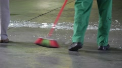 Two Workers, Cleaners, Green Uniform, Legs Closeup, Are Sweeping The Floor, Stock Footage