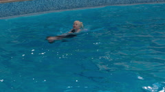 Little Girl Floats on a Dolphin Stock Footage